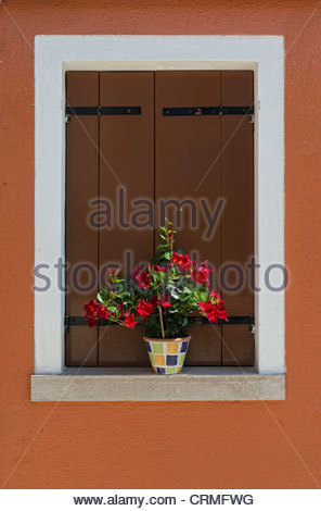 Colour contrasts in this typical Burano window - Burano is a colourful  Italian island village / small town in the - Stock Photo