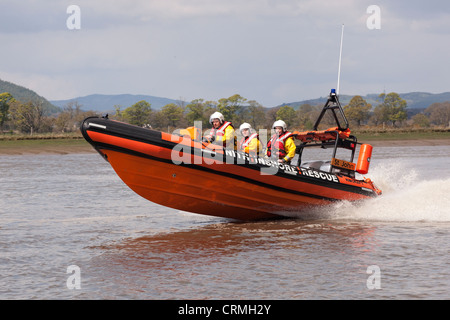 Rigid inflatable boat Nith Inshore Rescue independent lifeboat practising just of Glencaple in the River Nith Estuary, - Stock Photo