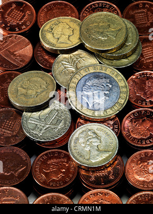 Piles of British pennies with one and two pound coins - Stock Photo