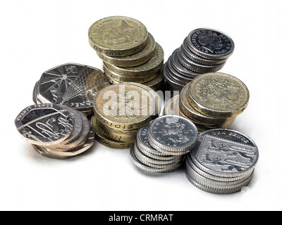 Piles of British coins, pounds and silver - Stock Photo