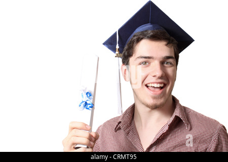 High school male graduate holding his graduating diploma and wearing a blue cap with tassel on a white background - Stock Photo