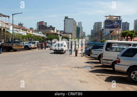 Africa, Mozambique, Maputo. Typical street scene in downtown Maputo. - Stock Photo