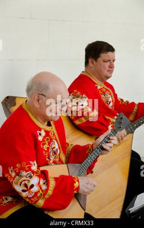 Ukraine, Yalta, Livadia Palace. Ukrainian folkloric show. Men playing Russian three-stringed balalaika. - Stock Photo