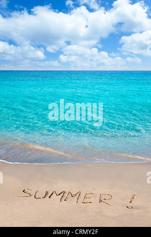 Caribbean tropical beach with Summer word written in sand - Stock Photo