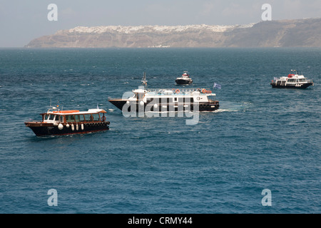 Tenders off the island of Santorini, waiting to take passengers ashore, Santorini, Greece - Stock Photo
