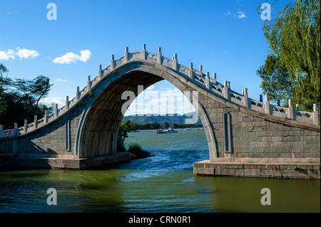 Arch bridge in Summer Palace, China - Stock Photo