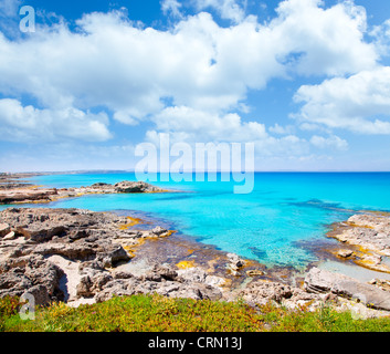 Balearic formentera island in escalo rocky beach and turquoise sea - Stock Photo