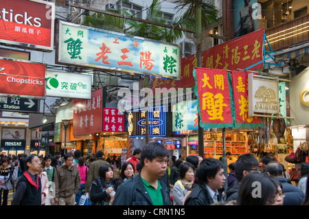 Crowd of people walking on street in downtown Hong Kong China - Stock Photo