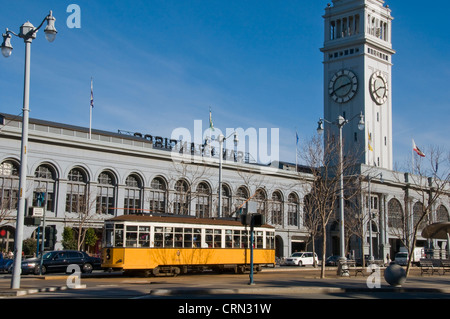 Old electric bus on downtown street in San Francisco CA USA - Stock Photo
