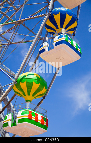Close up of the colourful chairs or capsules of a ferris wheel in Bulgaria - Stock Photo
