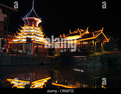 Village of Zhaoxing by night, Guizhou province - China - Stock Photo