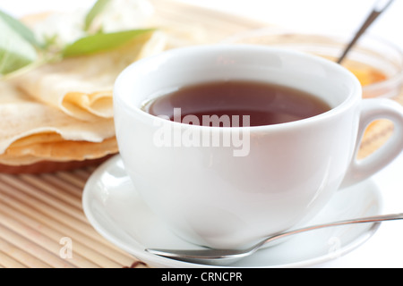 White cup of fragrant tea. Strong black tea - Stock Photo