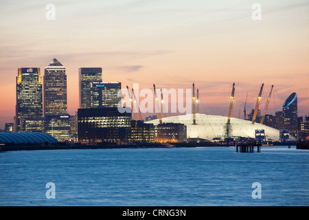 A view down the River Thames towards the O2 Arena and Canary Wharf at sunset. - Stock Photo