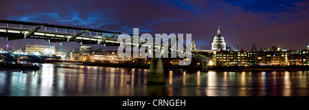 A panoramic view of the Millennium Bridge spanning the River Thames between Bankside on the South Bank and St Paul's - Stock Photo