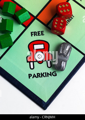 A Monopoly game board showing Free Parking - Stock Photo