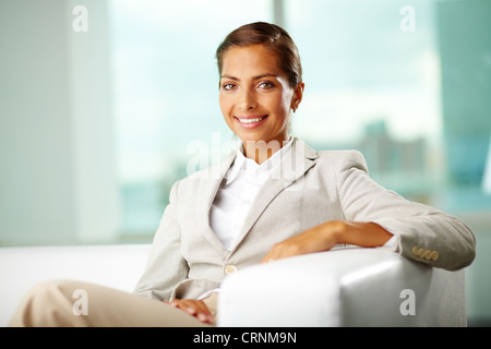 Smiling office woman representing positive attitude and success in business - Stock Photo