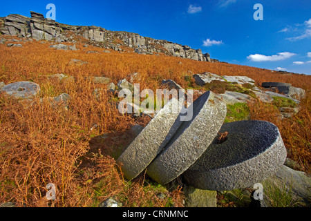 Abandoned millstones below High Neb on Stanage Edge in the Peak District National Park. - Stock Photo