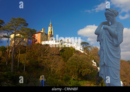 The clock tower and villas of Portmeirion from the grounds of the Portmeirion hotel situated on the sandy banks - Stock Photo