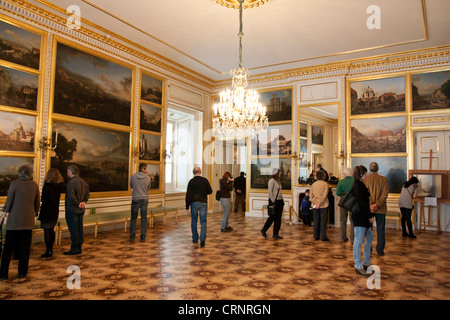Royal palace in Warsaw inside with tourists - Stock Photo