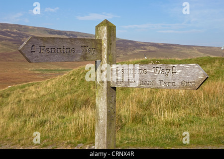 Pennine Way footpath sign near Pen Y Ghent showing direction and distance to Malham Tarn. - Stock Photo