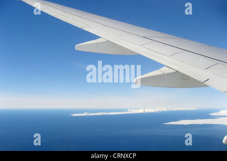 Global warming illustrated by wing and glaciers - Stock Photo