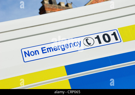 Non emergency telephone number 101 on the side of a police van. - Stock Photo