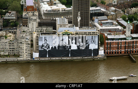 aerial view of giant Royal Family photograph poster from 1977 on the Sea Containers building on the River Thames, - Stock Photo