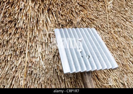 An old barn being re thatched in the Dorset village of Symondsbury, Dorset UK - Stock Photo