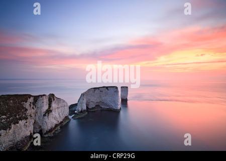Sunrise at Old Harry Rocks on Dorset's Jurassic Coast world heritage site near Swanage. - Stock Photo