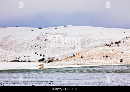 Snow covering the Alton Barnes white horse on Milk Hill looking out over Pewsey Vale. - Stock Photo