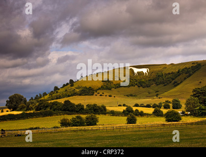 Stormy sky over the Westbury white horse, the oldest of Wiltshire's white horses, on the edge of the Bratton Downs. - Stock Photo