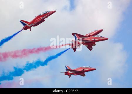 The Red Arrows aerobatic display at the Royal International Air Tattoo at RAF Fairford 2011. - Stock Photo