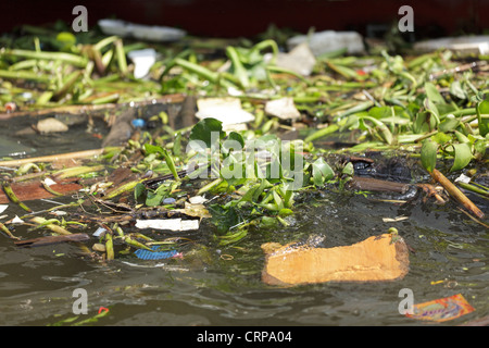 Floating trash pollution in water river, Bangkok, Thailand - Stock Photo