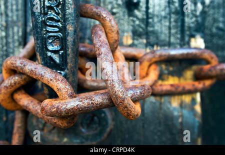 Close-up of a rusty padlock chain. - Stock Photo