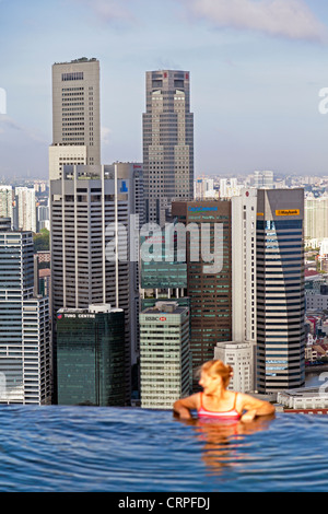 Sands SkyPark infinity swimming pool on the 57th floor of Marina Bay Sands Hotel, Marina Bay, Singapore, South East - Stock Photo