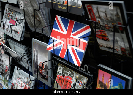 Postcards featuring London icons and a Union Flag on display in a rack. - Stock Photo