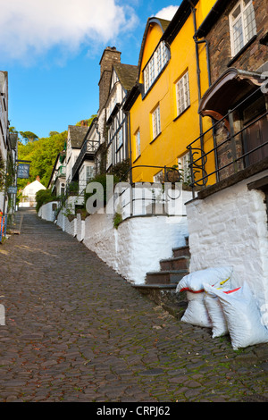 Steep narrow cobbled high street in the world famous fishing village of Clovelly. - Stock Photo