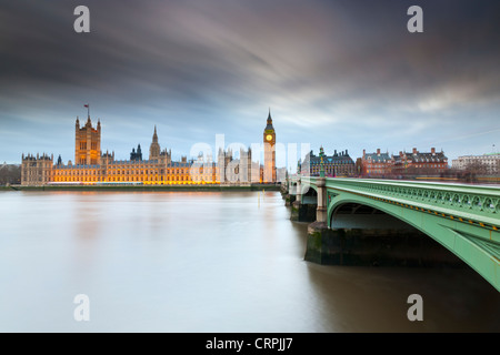 Westminster Bridge over the River Thames leading towards Big Ben and the Houses of Parliament. - Stock Photo