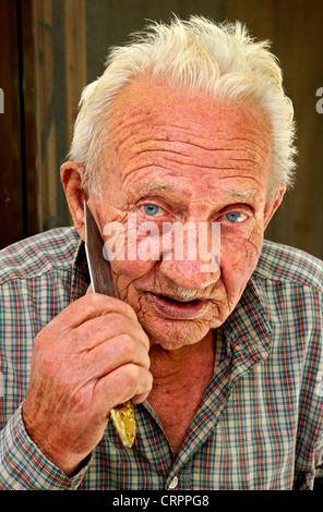 Mr. Spiros Argiros (87 y.o), from Agios Ilias village, one of the last traditional cutlers of Lefkada island, Ionian - Stock Photo