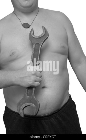 big wrench in a hand isolated on white - Stock Photo