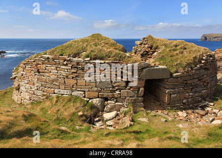 Ruined remains of ancient Broch of Borwick fortified stone round tower on west Mainland coast Yesnaby Orkney Islands - Stock Photo