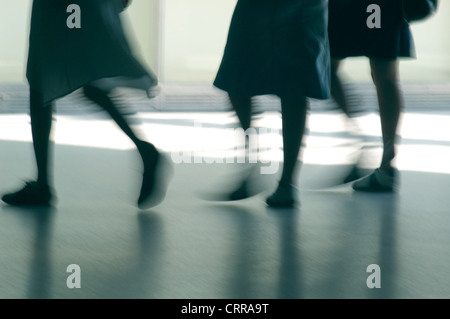 Silhouettes of legs of three girls and Skirts - Stock Photo