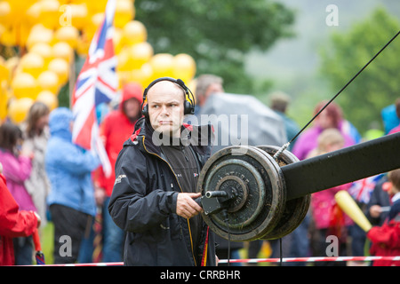 Filming the olympic torch relay through Ambleside, Lake District, UK. - Stock Photo