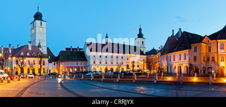 sibiu small square city center panorama at night in transylvania, romania - Stock Photo