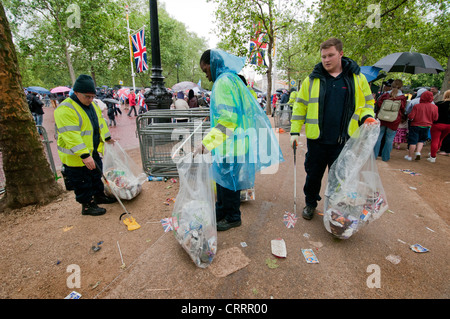 Team of men collecting litter after Diamond Jubilee event - Stock Photo