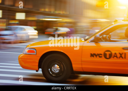 NEW YORK CITY, USA - JUNE 8: Blurry image of a NYC cab speeding in the city. June 8, 2012 in New York City, USA - Stock Photo