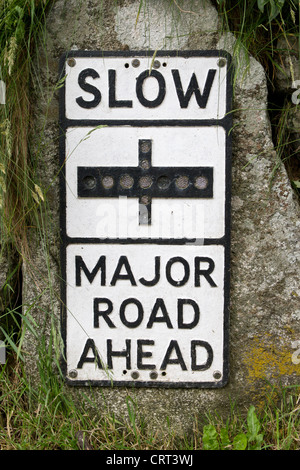 Vintage Old Road Sign SLOW Major Road Ahead - Stock Photo