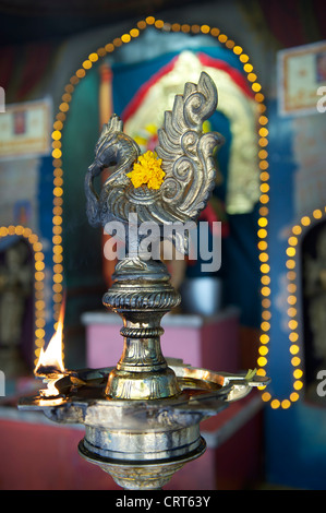 Ceremonial oil lamps seen at the Sri Veeramakaliamman Hindu temple in Little India, Singapore, Asia - Stock Photo