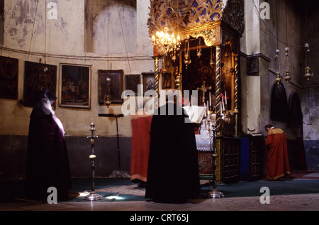 A religious ceremony takes place in the Church of the Nativity, which holds historic significance for Latin, Greek - Stock Photo