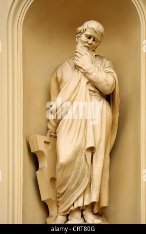 Berlin, Germany. Franzosischer Dom / French Cathedral in Gendarmenmarkt. Statue outside. - Stock Photo